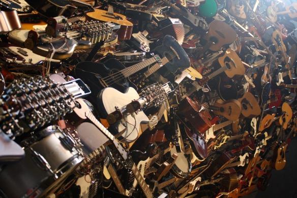 Huge Pile of Guitars